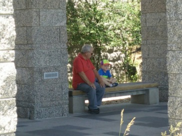Grandpa and Grandson at Mount Rushmore after delicious ice cream