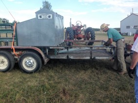 Loading the trailer with a calf feeder for Cowboy Dave