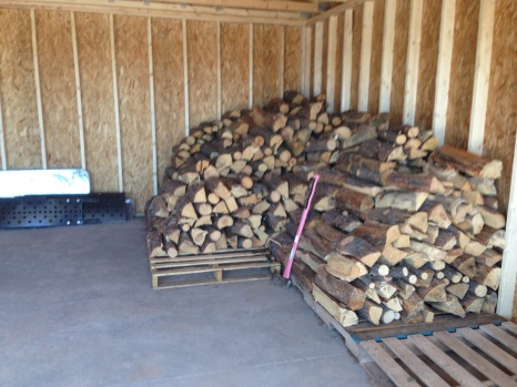 A lot of wood stacked AGAIN!
