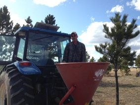 Tractor Dave cleaning out the broadcaster after seeding