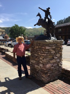 Admiring some cowboy art in Deadwood