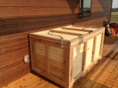 A big, beautiful wood box on the porch.