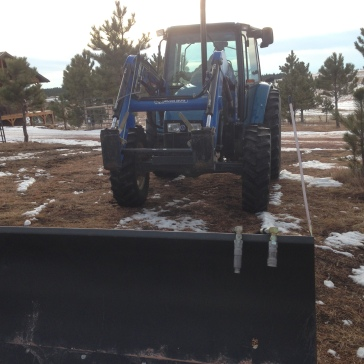 Tractor Dave driving to hook up the snow plow