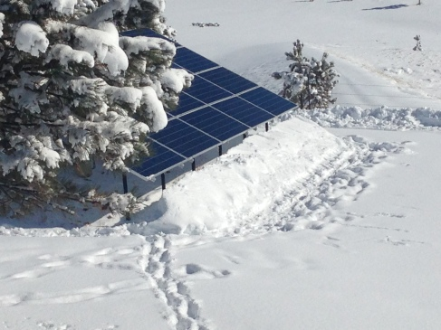 Clear solar panels, notice the large snowpile in front!