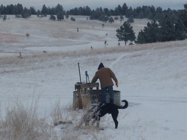 Rancher Dave breaking ice at the water tank